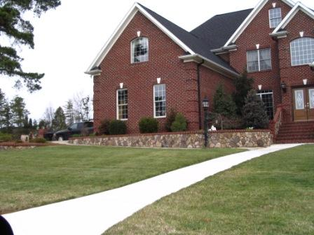 Stone Retaining Wall with Brick House